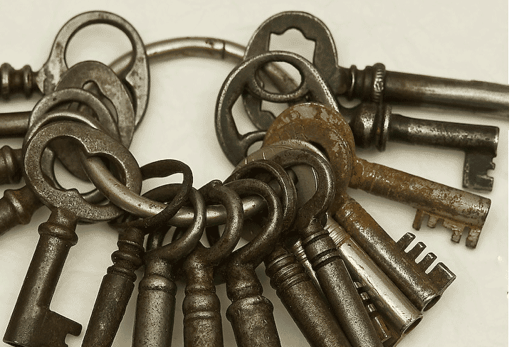 A collection of antique brass keys.